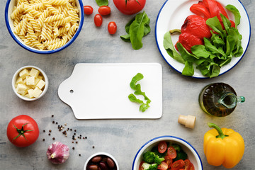 Ingredients pasta salad with vegetables and cheese. Concept of healthy eating, vegan food.Top view, food background