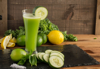 Refreshing Green Juice blend - Cool cucumbers, with a splash of lime and mint in a tall glass. Closeup, delicious image.