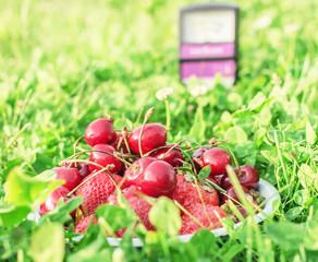 Cherries and strawberries in grass