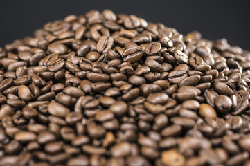 Close up shot of a pile of coffee beans