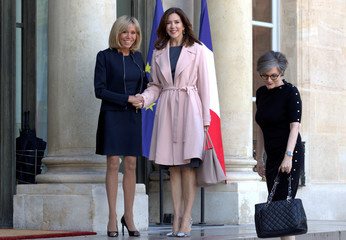 Brigitte Trogneux, wife of French President Emmanuel Macron, welcomes Crown Princess Mary of Denmark at the Elysee Palace in Paris