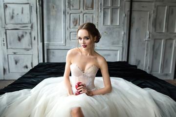 Portrait of a beautiful bride. Bride's fees in the studio