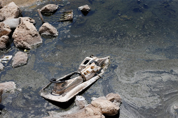 A scrap jet-ski is seen in a sewage nearby the sea of Ramlet al Bayda public beach in Beirut