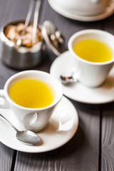Two Cups of Tea on Dark Wooden Background, Vertical View