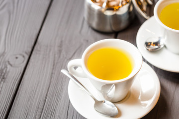 Two Cups of Camomile or Green Tea on Wooden Background, Horizontal Wallpaper, Free Space for Text