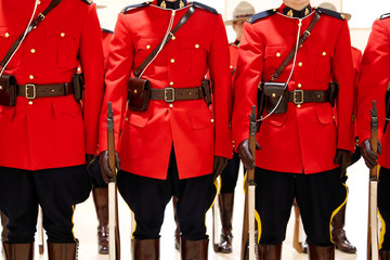 Royal Canadian Mounted Police (RCMP) cadets await badge presentations at a graduation ceremony in Regina