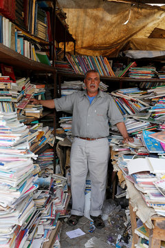 A bookseller stands in his bookshop in Bab Doukkala in the city of Marrakech