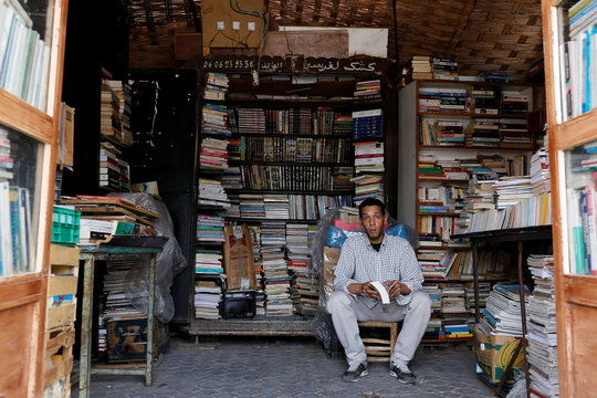 Bookseller Mohammed Khayi sits in his bookshop in Bab Doukkala in the city of Marrakech