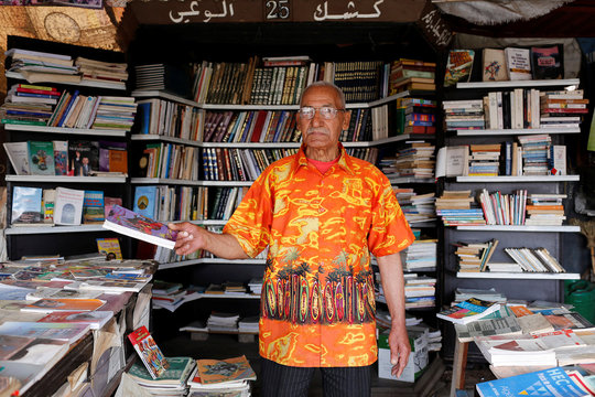 Bookseller Omar Zouita poses in his bookshop in Bab Doukkala in the city of Marrakech