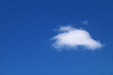 A small white cloud on a blue sky