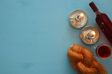 shabbat image. challah bread, wine and candles. Top view