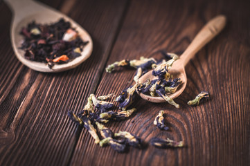 flower tea in wooden spoons and white cup