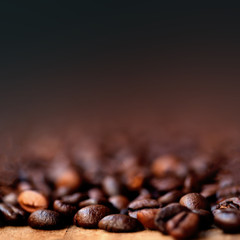 Coffee Beans Caffeine Roasted Brown Espresso wallpaper with copy space  close up. Fried  Coffee Beans Texture macro