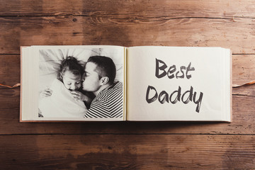 Fathers day concept. Photo album, black-and-white picture.