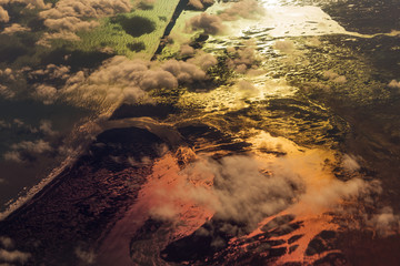 Aerial view of river and ocean in Iceland. Dark colorful landscape, melting glaciers
