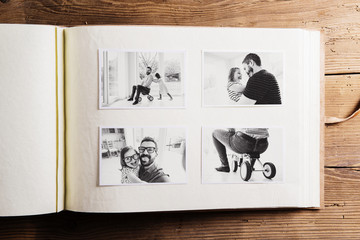 Fathers day concept. Photo album. Wooden background.