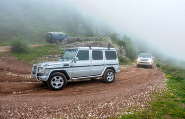 A column of jeeps in off-road adventure