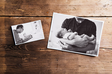 Pictures of father and baby, wooden background. Fathers day.