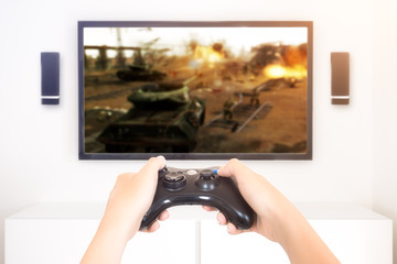 Player playing console war game videogame holding gamepad - high key image