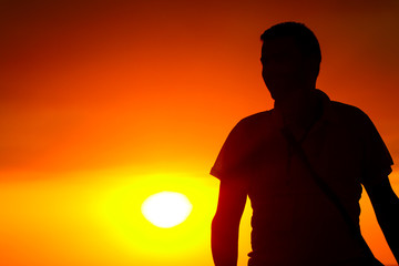 Beautiful view of sunset with man look.