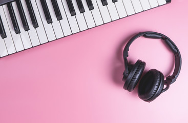 Music Studio Keyboard and Headphone on pink copy space