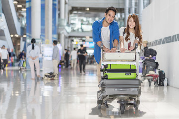 Couple asian traveler in happy moment with baggage at airport terminal. Travel summer concept.