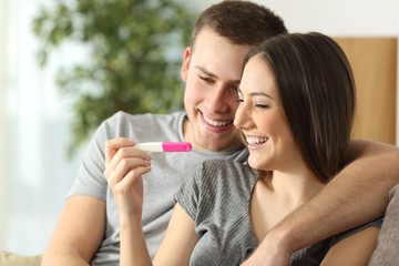 Happy couple checking pregnancy test