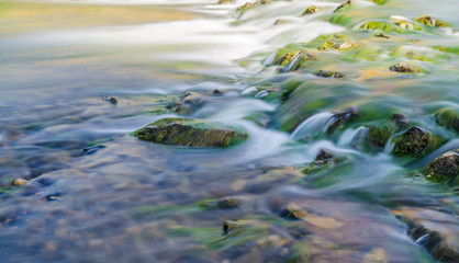 Background of Carpathian mountain river with long exposure