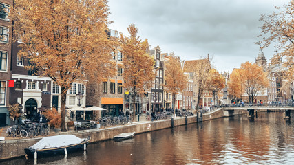 Amsterdam's canal in the autumn day