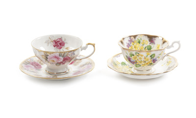 Beautiful vintage tea cups and saucers collection, isolated on a white background.