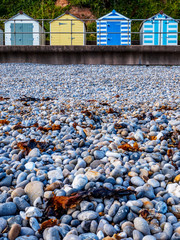 Budleigh Beach Huts and rocks