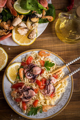 Noodles with seafood on a wooden background