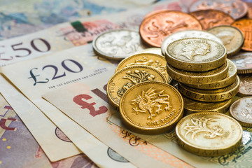 British coins stack on black, pound sterling Fototapete