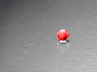 red ball on an aluminum background