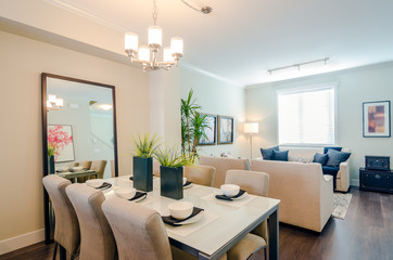 Modern bright dining room with a living room in a luxury apartment. Interior design.