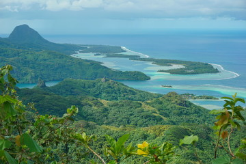 Fotobehang Blauw Huahine island landscape from the mountain Pohue Rahi, forest with the lagoon and islets, south Pacific ocean, Leeward islands, French Polynesia