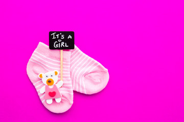 Baby Girl - pink and white socks with bear on pink background with It's a Girl blackboard sign