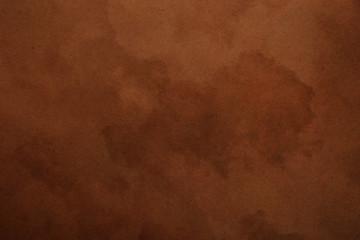 Old dark brown paper parchment background