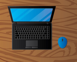 laptop and mouse on wooden background
