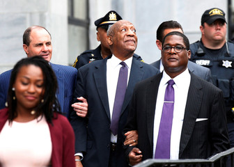 Actor and comedian Bill Cosby leaves with his spokesman Andrew Wyatt after the second day of his sexual assault trial at the Montgomery County Courthouse