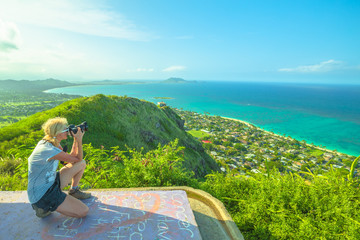 Travel photographer takes shot of Lanikai Beach and Kailua Beach in Oahu East shore, Hawaii, USA. Nature photographer taking pictures outdoors during hawaiian hiking Lanikai Pillbox Hike.