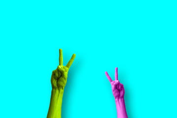 two hands doing the peace sign in a colorful pop art style
