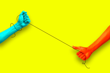 two hands pulling a wire against each other in a colorful pop art style