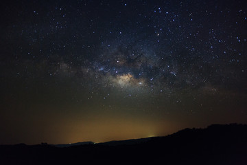 Milky Way over mountain at Phu Hin Rong Kla National Park,Phitsanulok Thailand, Long exposure photograph.with grain