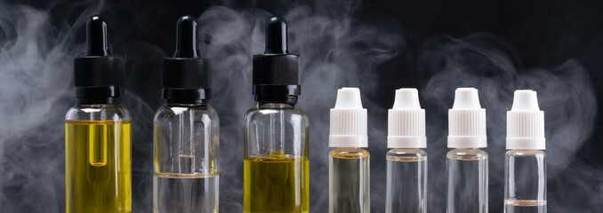 bottles with different flavors for electronic cigarettes, on the background pair