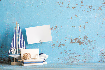 Decorative marine items on wooden background.