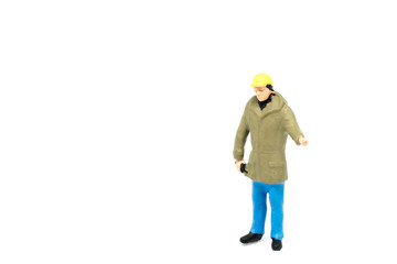 Miniature people engineer worker construction on white background with a space for text