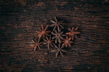 Anise stars on wood background.