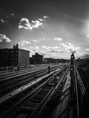 Subway railway tracks with cloudy sky in black and white