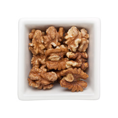 Roasted walnut in a square bowl isolated on white background